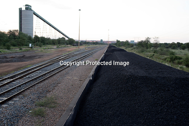 Train carriages loaded with coal close to the newly constructed Medupi power station stands outside the northern South African town of Lephalale. The plant, operated by the state company Eskom will be the fourth largest in the world and is expected to produce electricity in early 2015. Medupi is touted as Africa's first 'supercritical' coal plant, using higher temperatures that produce more energy from less coal, while emitting less ash and carbon dioxide. South Africa, like China and India, has large domestic coal supplies that provide a cheap source of energy to meet an ever-growing demand.