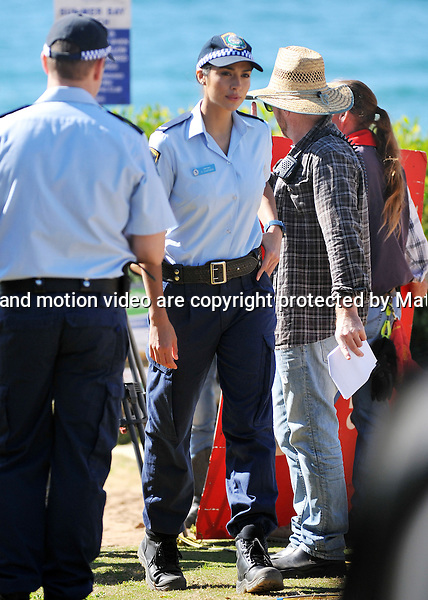 9th September, 2014 SYDNEY AUSTRALIA<br />  EXCLUSIVE <br /> Steve Peacocke arrested<br /> Pictured,  Steve Peacocke, Pia Miller, Bonnie Sveen and Greg ?, cast members of Home and Away doing an arrest scene at the &quot;Summer Bay&quot; surf club , Palm Beach, NSW. <br /> <br /> *No internet without clearance*.MUST CALL PRIOR TO USE +61 2 9211-1088. Matrix Media Group.Note: All editorial images subject to the following: For editorial use only. Additional clearance required for commercial, wireless, internet or promotional use.Images may not be altered or modified. Matrix Media Group makes no representations or warranties regarding names, trademarks or logos appearing in the images.