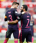 FC Barcelona's Arda Turan (r) and Gerard Pique celebrate goal during La Liga match. September 24,2016. (ALTERPHOTOS/Acero)