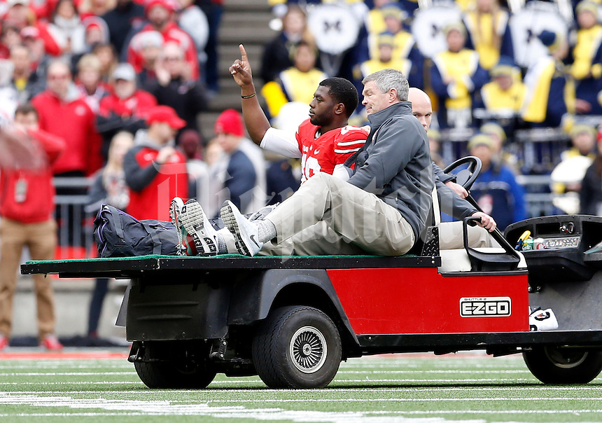 Ohio State Buckeyes quarterback J.T. Barrett (16) leaves the field on a cart after he went down with an ankle injury during the 4th quarter of the NCAA football game against the Michigan Wolverines at Ohio Stadium on Nov. 29, 2014. (Adam Cairns / The Columbus Dispatch)