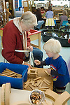 "Berkeley CA Grandmother helping grandson, four-years-old, build with construction toy during school ""Grandparents' Day"""