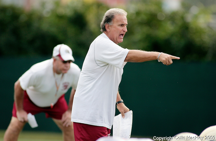 TALLAHASSEE, FL. 8/13/09-FSU-AMATO 0812 CH01-Florida State Linebacker Coach Chuck Amato, center,  directs his players as Defensive Coordinator Mickey Andrews, left, watches during practice Thursday in Tallahassee...COLIN HACKLEY PHOTO