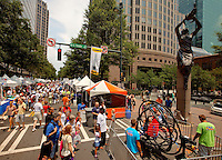 Uptown Charlotte NC held its 13th annual Taste of Charlotte food festival June 10-12, 2011 in the center city. Visitors sampled food samples and beverages from top-name restaurants and enjoyed the entertainment of street performers, climbing walls, bounce houses and more.