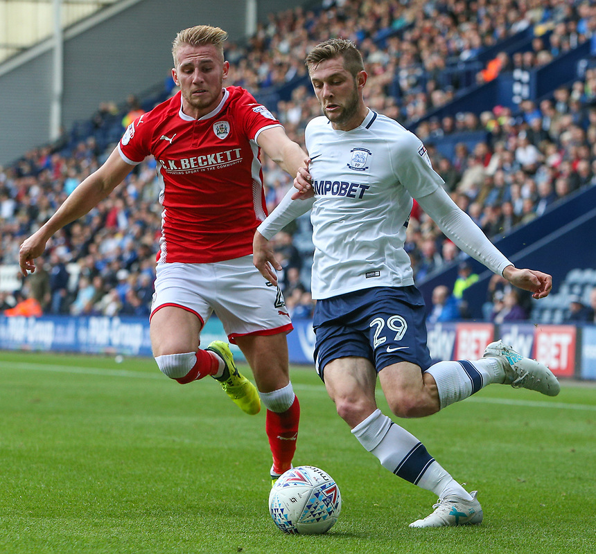 Preston North End's Tom Barkhuizen gets a cross in despite the attentions of Barnsley's Jason McCarthy<br /> <br /> Photographer Alex Dodd/CameraSport<br /> <br /> The EFL Sky Bet Championship - Preston North End v Barnsley - Saturday 9th September 2017 - Deepdale Stadium - Preston<br /> <br /> World Copyright &copy; 2017 CameraSport. All rights reserved. 43 Linden Ave. Countesthorpe. Leicester. England. LE8 5PG - Tel: +44 (0) 116 277 4147 - admin@camerasport.com - www.camerasport.com