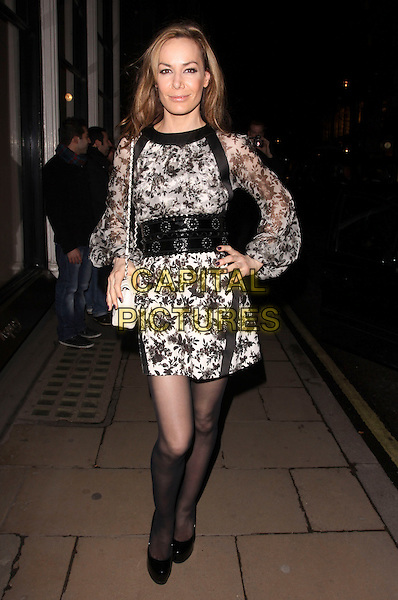 TARA PALMER TOMKINSON.attending the book launch party for Simon Sebag Montefiore's latest book, 'Jerusalem: the Biography, a fresh history of the Middle East' at Asprey, London, England, UK,.January 26th 2011..full length TPT black print dress  tights shoes white chanel quilted 2.55 bag grey gray sheer top sleeves platform hand on hip  .CAP/AH.©Adam Houghton/Capital Pictures.