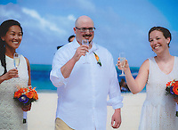 Kim Bauer, Josh Giles, and Kate Fink raise their glasses during the wedding ceremony on Friday