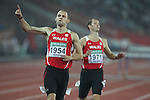 Delhi 2010 Commonwealth Games.Dai Greene celebrates as he crosses the line to take gold in the Mens 400m Hurdles leaving behind fellow Welsh athlete Rhys Wiiliams to take bronze..10.10.10.Photo Credit-Steve Pope-Sportingwales