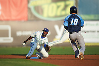 Hartford Yard Goats second baseman Juan Ciriaco (2) waits for a throw as Dustin Fowler (10) runs to the bag during the second game of a doubleheader against the Trenton Thunder on June 1, 2016 at Sen. Thomas J. Dodd Memorial Stadium in Norwich, Connecticut.  Trenton defeated Hartford 2-1.  (Mike Janes/Four Seam Images)