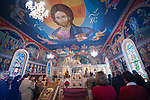 Christ the Pantocrator looms over the congregation during Christmas Liturgy Service, St. Sava Serbian Orthodox Church, Jackson, Calif..The icons were painted by iconographer Miloje Milinkovic of Beograd.