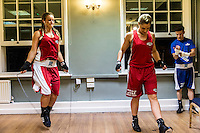 Emily Williams and another female boxer prepare for their fights at the London Irish Centre where a regular event - the 'Carpe Diem' bout - is taking place. <br /> <br /> 'White-collar boxing' is a growing phenomenon amongst well paid office workers and professionals and has seen particular growth in financial centres like London, Hong Kong and Shanghai. It started at a blue-collar gym in Brooklyn in 1988 with a bout between an attorney and an academic and has since spread all over the world. The sport is not regulated by any professional body in the United Kingdom and is therefore potentially dangerous, as was proven by the death of a 32-year-old white-collar boxer at an event in Nottingham in June 2014. The London Irish Centre, amongst other venues, hosts a regular bout called 'Carpe Diem'. At most bouts participants fight to win. Once boxers have completed a few bouts they can participate in 'title fights' where they compete for a replica 'belt'.