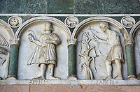 Late medieval relief sculpture depicting the labours for March and April and astrological signs on the Facade of the Cattedrale di San Martino,  Duomo of Lucca, Tunscany, Italy,