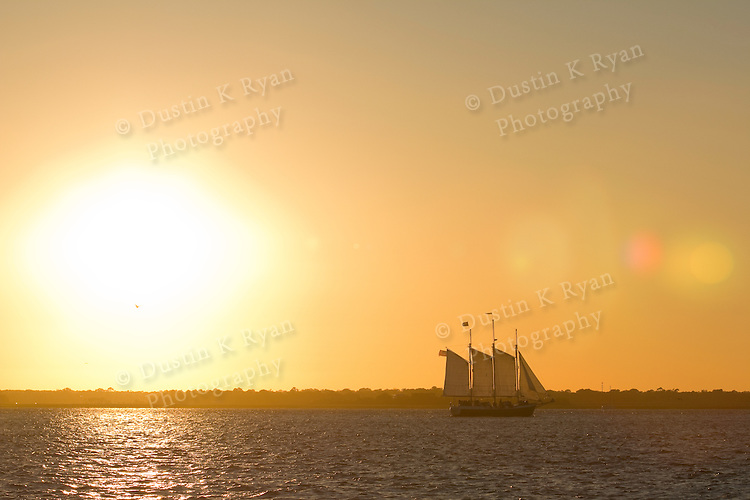 Schooner Pride Sailboat Sailing the Charleston Harbor during Sunset