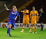 Grant Munro celebrates his long rage equalising goal for Caley