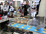 June 8, 2016, Tokyo, Japan - Japanese food machinery maker Aichi displays dorayaki or bean-jam pancake making machine at the International Food Machinery and Technology Exhibition in Tokyo on Wednesday, June 8, 2016. 688 Japanese and foreign food machinery companies are exhibiting their latest technology and products in the four-day trade show.   (Photo by Yoshio Tsunoda/AFLO) LWX -ytd-