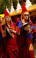Buddhist lama playing cymbals in a Losar ceremony, Sikkim, India