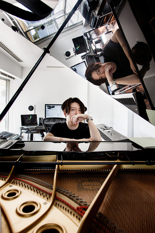 "Tokyo, September 12 2013 - Portrait of Keiichiro Shibuya, musician and artist, at his office in Daikanyama. He wrote the music for ""The End"", a vocaloid opera featuring the humanoid persona Hatsune Miku."