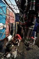 Rosarno / Calabria / Italia<br /> Immigrati impegnati nella piana di Gioia Tauro per la raccolta degli agrumi <br /> accampati fra le rovine di una fabbrica dismessa. Le condizioni di vita sono molto dure e sono vittime dello sfruttamento da parte della malavita organizzata.<br /> Illegal immigrants living in abandoned factory. Working in black. Collect citrus in the Plain of Gioia Tauro. The living conditions are very hard and are victims of exploitation by organized crime. <br /> Photo Livio Senigalliesi