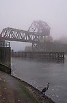 Fog along the Lake Washington Ship Canal. Ballard Railroad Trestle at West end of Chittenden lock. Heron at end of Chittenden locks.