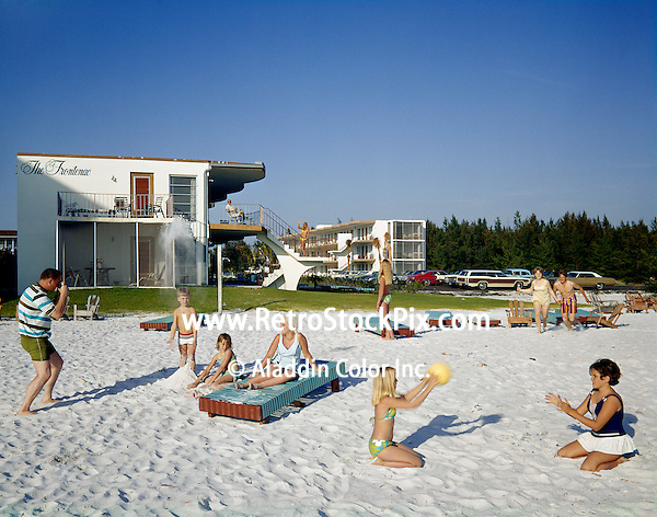Frontenac Motel, Sarasota, FL. Families playing & lounging on the beach.