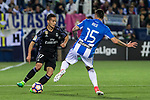 Lucas Vazquez of Real Madrid competes for the ball with Diego Rico of Club Deportivo Leganes during the match of  La Liga between Club Deportivo Leganes and Real Madrid at Butarque Stadium  in Leganes, Spain. April 05, 2017. (ALTERPHOTOS / Rodrigo Jimenez)