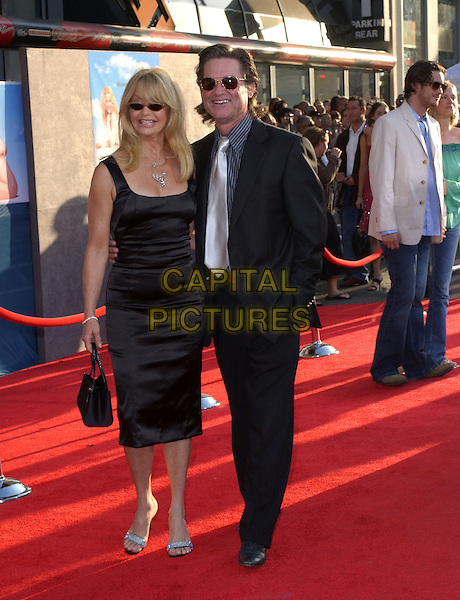 GOLDIE HAWN & KURT RUSSELL.Attend Touchstone Pictures' Los Angeles Premiere of Raising Helen held at The El Capitan Theatre .May 26,2004.full length, full-length, celebrity couple, black dress, sunglasses, shades.www.capitalpictures.com.sales@capitalpictures.com.©Capital Pictures