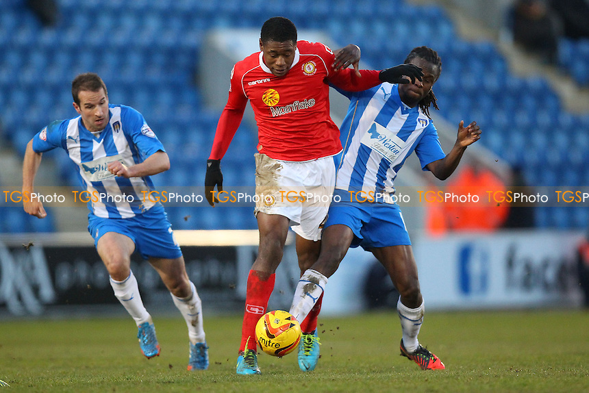 Chuks Aneke of Crewe evades Marcus Bean of Colchester - Colchester United vs Crewe Alexandra - Sky Bet League One Football at the Weston Homes Community Stadium, Colchester, Essex - 29/12/13 - MANDATORY CREDIT: Gavin Ellis/TGSPHOTO - Self billing applies where appropriate - 0845 094 6026 - contact@tgsphoto.co.uk - NO UNPAID USE