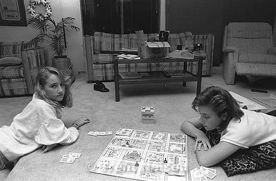 April and Christina Nelson playing a board game.<br />