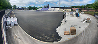 Technicians with Hellas Construction in Austin, Texas, work Wednesday, May 20, 2020, to install a new playing surface at Fayetteville High Schoo's Harmon Stadium. Visit nwaonline.com/200521Daily/ for today's photo gallery.<br /> (NWA Democrat-Gazette/Andy Shupe)
