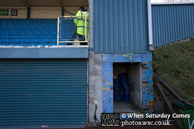 Greenock Morton 2 Stranraer 0, 21/02/2015. Cappielow Park, Greenock. A steward on patrol in the away end of the main stand before Greenock Morton take on Stranraer in a Scottish League One match at Cappielow Park, Greenock. The match was between the top two teams in Scotland's third tier, with Morton winning by two goals to nil. The attendance was 1,921, above average for Morton's games during the 2014-15 season so far. Photo by Colin McPherson.