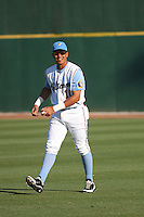 Myrtle Beach Pelicans infielder Edwin Garcia #10 walking in the outfield before a game against the Wilmington Blue Rocks at Tickerreturn.com Field at Pelicans Ballpark on April 8, 2012 in Myrtle Beach, SC. Wilmington defeated Myrtle Beach 3-2. (Robert Gurganus/Four Seam Images)