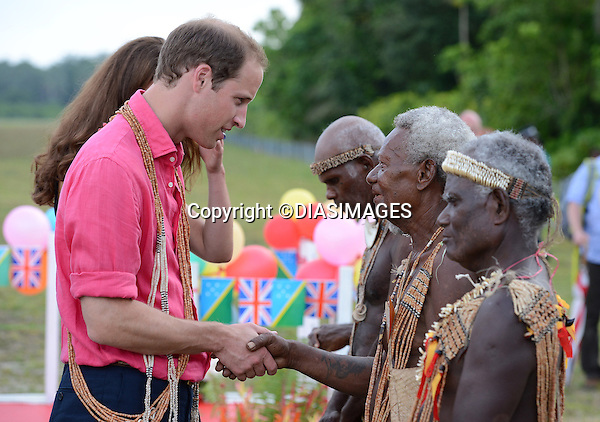 """CATHERINE, DUCHESS OF CAMBRIDGE AND PRINCE WILLIAM.receive a traditional tribal welcome as they land in Marau on their way to Tavanipupu, Solomon Islands_17/09/2012.Mandatory credit photo: ©DIASIMAGES/NEWSPIX INTERNATIONAL..""""NO UK USE FOR 28 DAYS"""" ..(Failure to credit will incur a surcharge of 100% of reproduction fees)..                **ALL FEES PAYABLE TO: """"NEWSPIX INTERNATIONAL""""**..IMMEDIATE CONFIRMATION OF USAGE REQUIRED:.DiasImages, 31a Chinnery Hill, Bishop's Stortford, ENGLAND CM23 3PS.Tel:+441279 324672  ; Fax: +441279656877.Mobile:  07775681153.e-mail: info@newspixinternational.co.uk"""