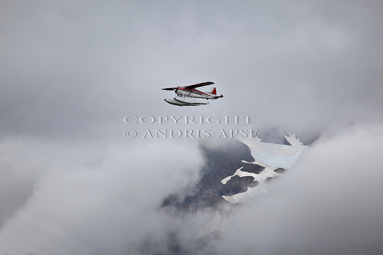 Floatplane in cloud. Prince William Sound. Alaska. U.S.A.