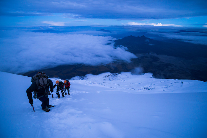 Climbers near the summit of Cotopaxi Volcano 5,897m glacier covered summit, Cotopaxi National Park, Cotopaxi Province, Ecuador