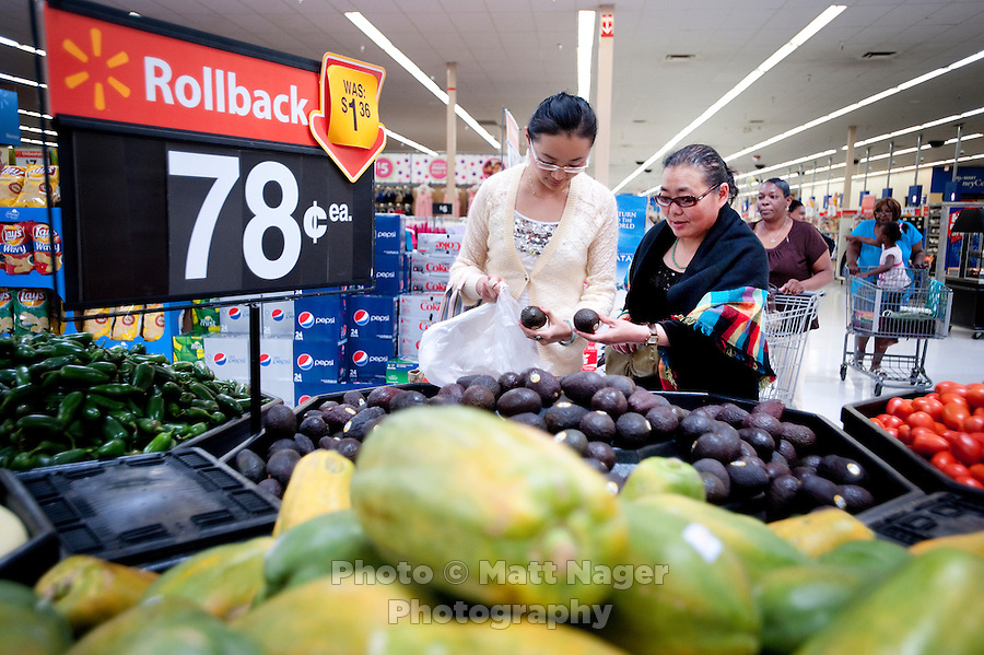 """Yue Zheng (cq, left) picks out ripe avocados with her mother Dongping Yuan (cq, left) at a WalMart in Lawton, Oklahoma, April 29, 2010. Zheng is adapting to life in the US after two years of teaching high school Chinese as part of a """"guest teacher"""" program...PHOTO/ MATT NAGER"""