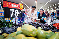 "Yue Zheng (cq, left) picks out ripe avocados with her mother Dongping Yuan (cq, left) at a WalMart in Lawton, Oklahoma, April 29, 2010. Zheng is adapting to life in the US after two years of teaching high school Chinese as part of a ""guest teacher"" program...PHOTO/ MATT NAGER"