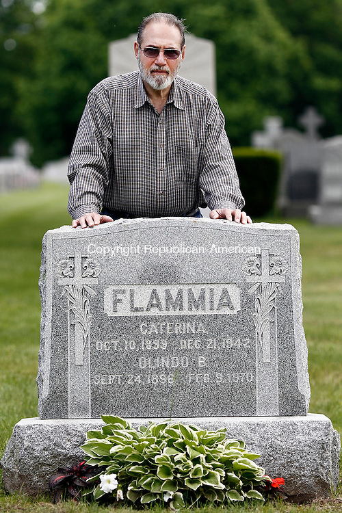 Waterbury, CT- 30 May 2014-053014CM12-   Richard Testone of Wolcott, stands in front his parents-in-law gravesite at Calvary Cemetery in Waterbury on Friday. The family says someone stole a stone angel that was on top of the headstone.    Christopher Massa Republican-American