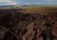 Aerials of the Bungle Bungles near Halls Creek AU. Named by the Kija Aboriginal people, the names means sandstone or may be a corruption of bundle grass.  The area is famous for sandstone domes and unusual coloring of the clay.  Located in Purnululu National Park, it is a World Heritage Site.