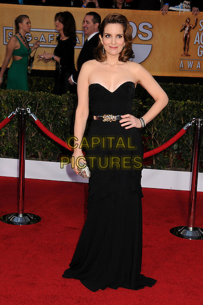 Tina Fey (wearing Oscar de la Renta).Arrivals at the 19th Annual Screen Actors Guild Awards at the Shrine Auditorium in Los Angeles, California, USA..27th January 2013.SAG SAGs full length dress black silver belt clutch bag strapless hand on hip.CAP/ADM/BP.©Byron Purvis/AdMedia/Capital Pictures