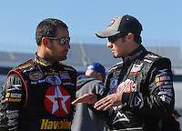 Mar 30, 2007; Martinsville, VA, USA; Nascar Nextel Cup Series driver Juan Pablo Montoya (42) talks with teammate David Stremme (40) during practice for the Goody's Cool Orange 500 at Martinsville Speedway. Martinsville marks the second race for the new car of tomorrow. Mandatory Credit: Mark J. Rebilas