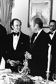 United States President Gerald R. Ford, right, and Prime Minister Pierre Elliott Trudeau of Canada, left, attend a working dinner in the Prime Minister's honor at the White House in Washington, DC on December 4, 1974.  <br /> Mandatory Credit: Jack Kightlinger / White House via CNP