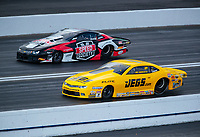 Feb 9, 2019; Pomona, CA, USA; NHRA pro stock driver Jeg Coughlin Jr (near) races alongside Alex Laughlin during qualifying for the Winternationals at Auto Club Raceway at Pomona. Mandatory Credit: Mark J. Rebilas-USA TODAY Sports