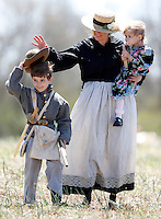 Michelle McMahan helps her son Rhett put his hat on his head while holding her daughter Ava before the Battle of Anderson Civil War re-enactment on Sunday.