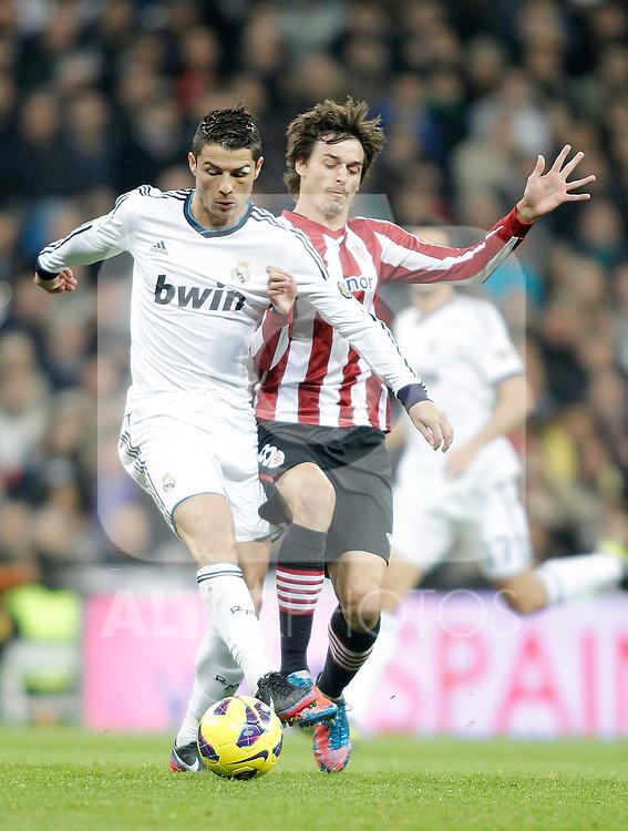 Real Madrid's Cristiano Ronaldo against Athletic de Bilbao's Ander Iturraspe during La Liga Match. November 17, 2012. (ALTERPHOTOS/Alvaro Hernandez)