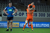 Tomas Lezana and Joaquin Tuculet celebrates at the final whistle as Dalton Papali'i (left) reflects on the loss after the Super Rugby match between the Blues and Jaguares at Eden Park in Auckland, New Zealand on Friday, 28 April 2018. Photo: Dave Lintott / lintottphoto.co.nz
