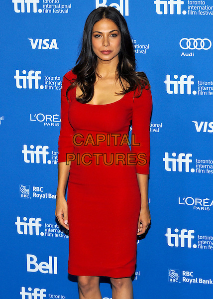 Moran Atias<br /> &quot;Third Person&quot; Press Conference  - 2013 Toronto International Film Festival held at TIFF Bell Lightbox, Toronto, Ontario, Canada.<br /> September 10th, 2013<br /> half length red dress 3/4 <br /> CAP/ADM/BPC<br /> &copy;Brent Perniac/AdMedia/Capital Pictures