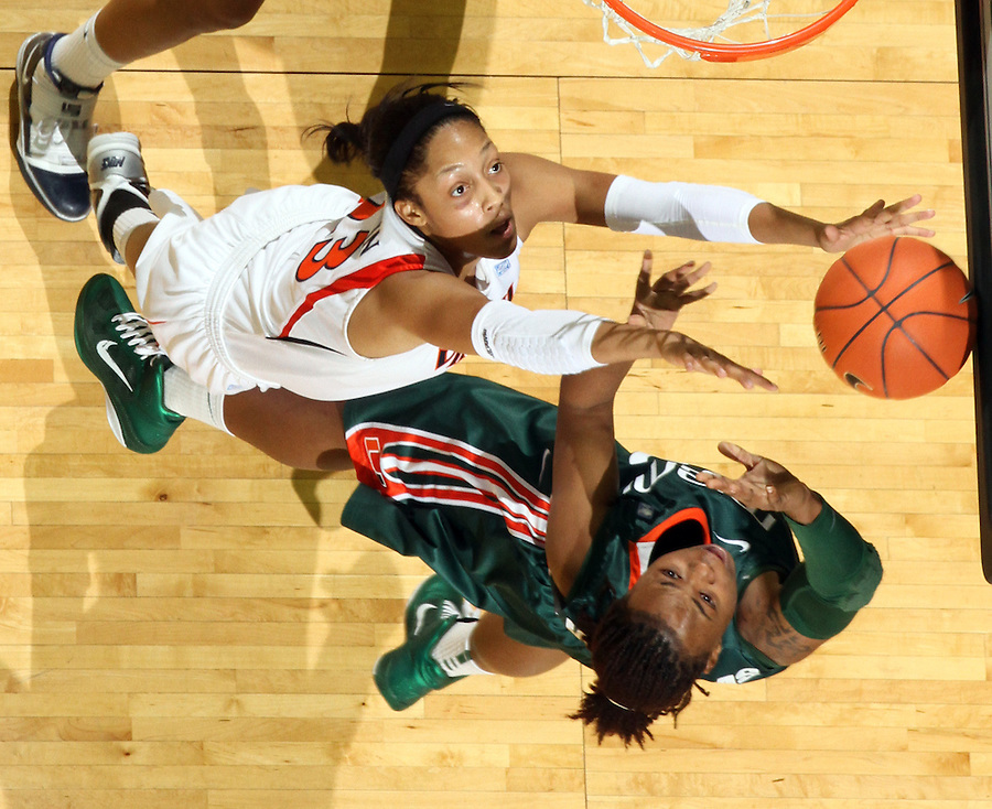 Jan. 6, 2011; Charlottesville, VA, USA; Virginia Cavaliers guard Ataira Franklin (23) reachs for the rebound with Miami Hurricanes guard Shenise Johnson (42) during the game at the John Paul Jones Arena. Miami won 82-73. Mandatory Credit: Andrew Shurtleff-