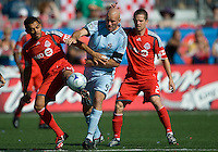 12 September 2009: Colorado Rapids forward Conor Casey #9 and Toronto FC midfielder Amado Guevara #20 battle for a ball during MLS action at BMO Field Toronto in a game between Colorado Rapids and Toronto FC. .Toronto FC won 3-2..