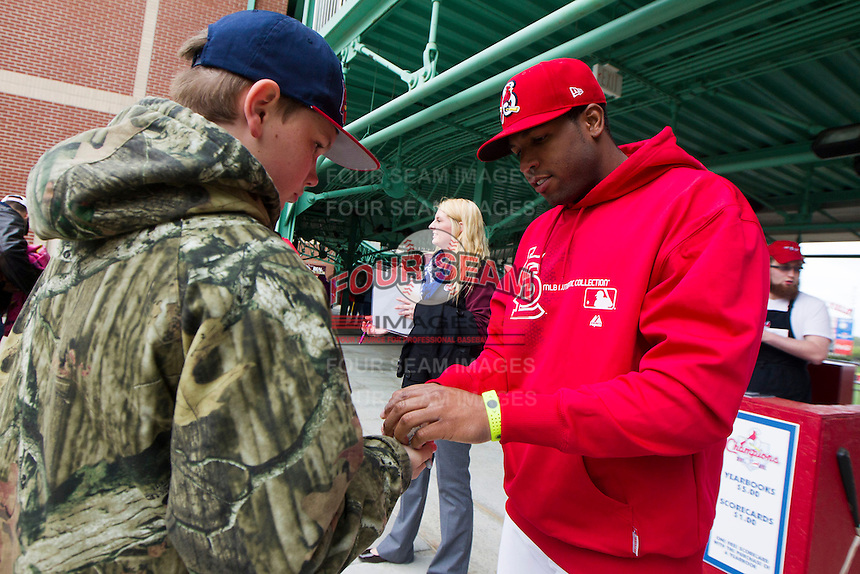 Xavier Scruggs #15 of the Springfield Cardinals signs autographs for a fan prior to a game against the Tulsa Drillers at Hammons Field on May 4, 2013 in Springfield, Missouri. (David Welker/Four Seam Images)
