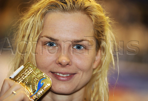 11.12.2011. Szczecin, Poland.  Britta Steffen of Germany displays her gold medal after winning the 50m Freestyle final at the Swimming short course European Championships in Szczecin, Poland, 11 December 2011.