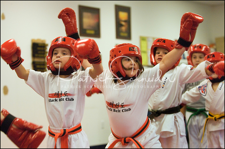 Children participate in a class of the sport of Tae Kwan Do.  Photographer has many photos of children participating in Tae Kwan Do classes (at different ages and different belt/degrees of achievement).
